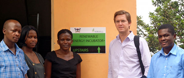 Team standing next to office directional sign 700x300