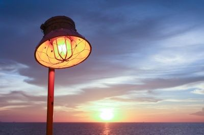 "Lighting Of Warm Lamp And Lighting Of Sunset At Sea"" by theerapong82"