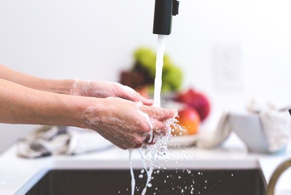 Canva - Person Washing Hands