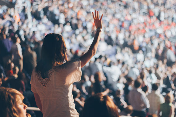 Canva - Woman With White Shirt Raising Her Right Hand