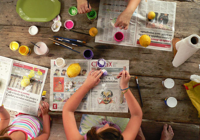 Canva - Kids Painting on a Table