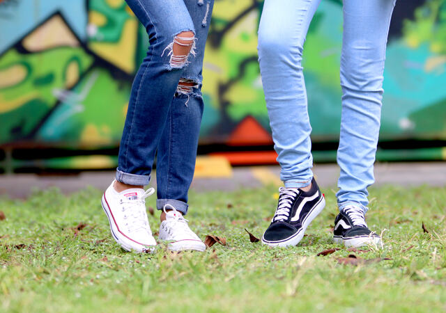 Canva - Person\'s Wearing White and Black Low-top Sneakers