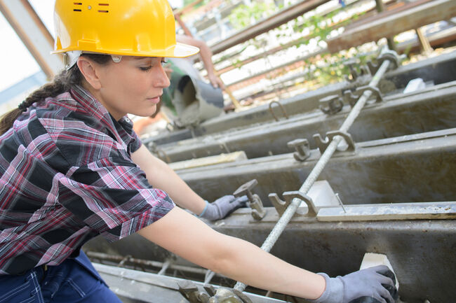 Woman at work on building site
