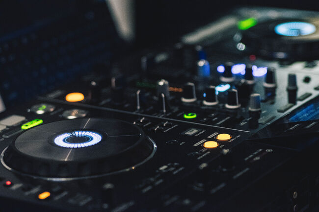 Canva - Shallow Focus Photography of Black Dj Controller